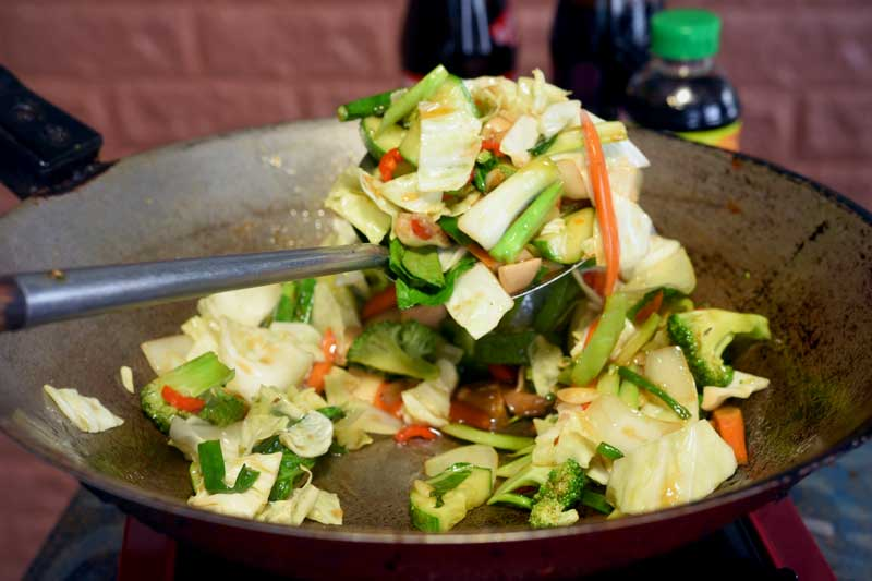 Stir frying Thai vegetables