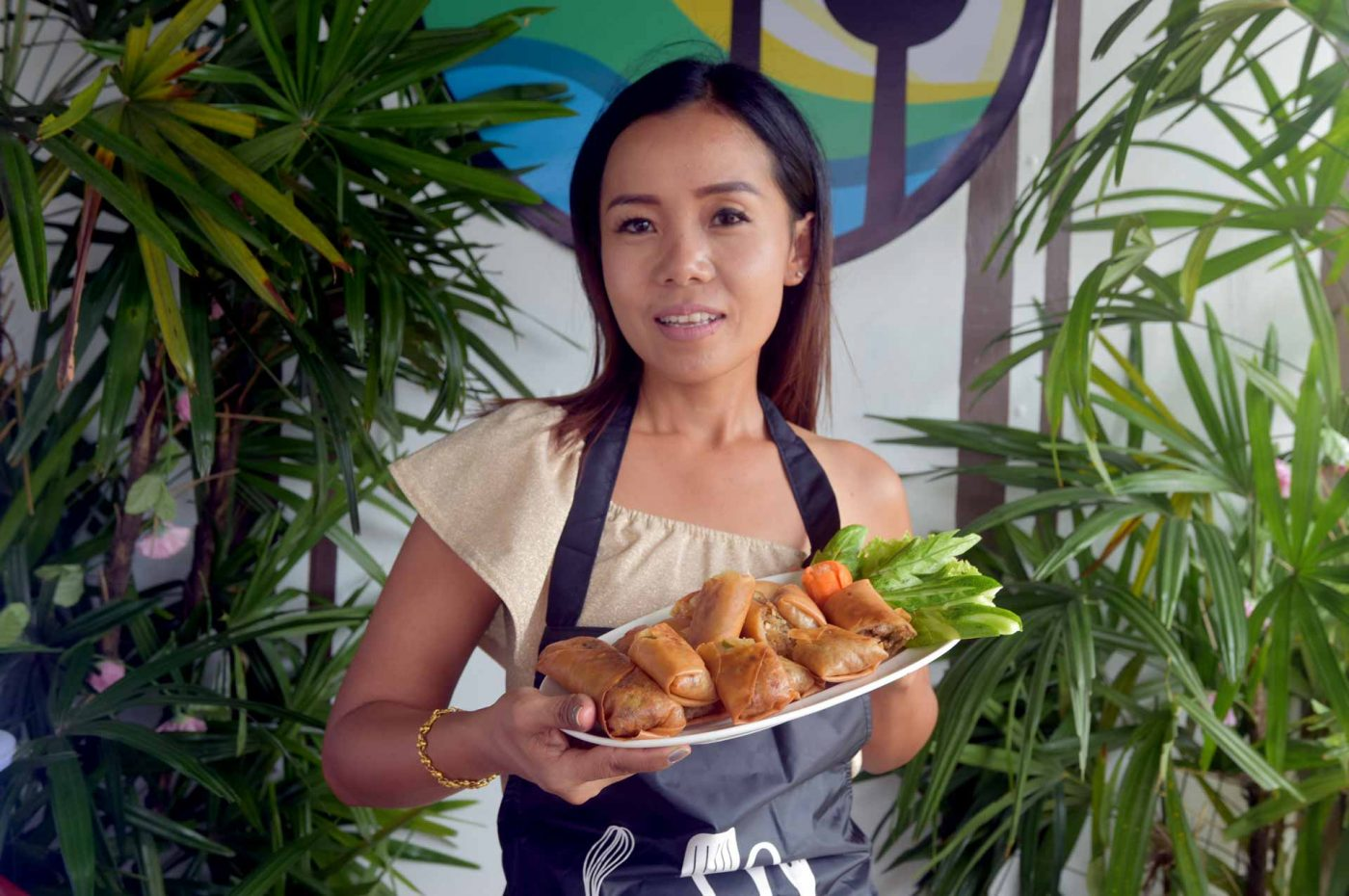 Apple holding spring rolls at her Thai cooking class in Khao Lak