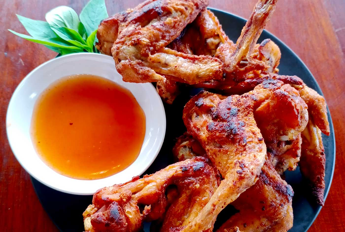 Fried chicken wings in fish sauce