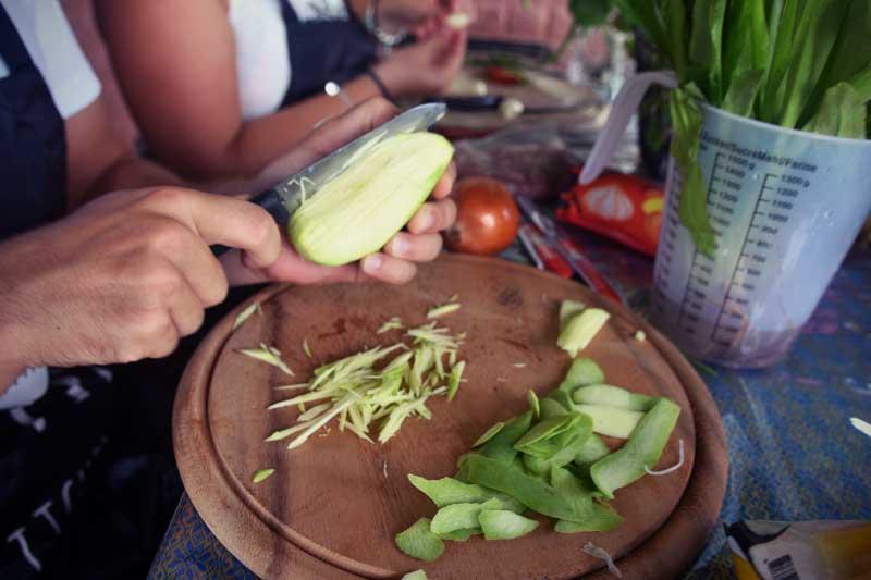 Chopping the mango.