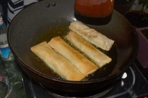 Frying spring rolls until golden brown