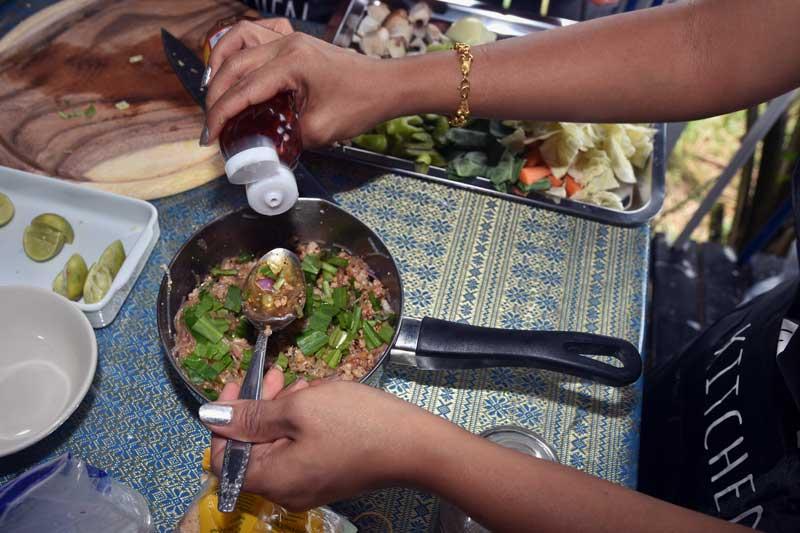 Adding fish sauce