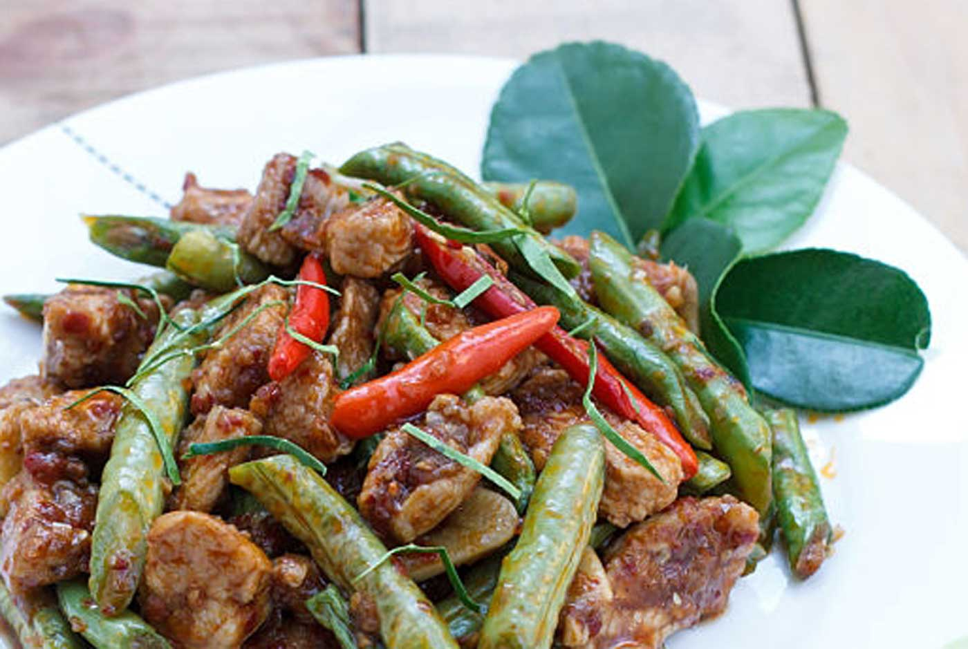 Pork fried in red curry paste